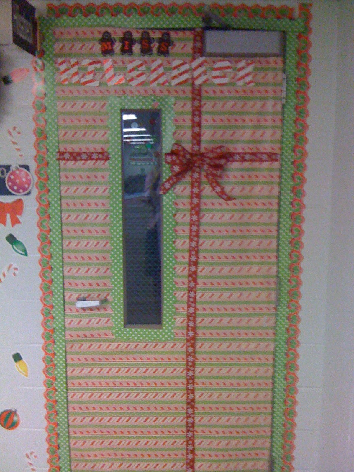 Christmas Front Door---wrapping paper or fabric to (cover up window).