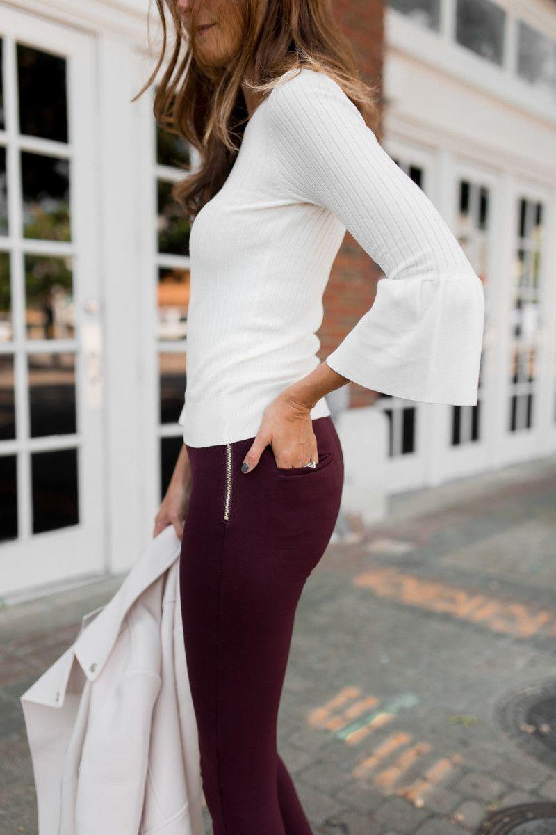 The Miller Affect wearing burgundy leggings to work