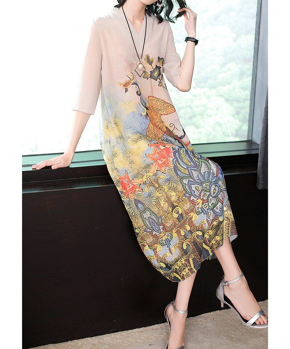 Take a look at this Ivory Floral Bird Midi Dress Women