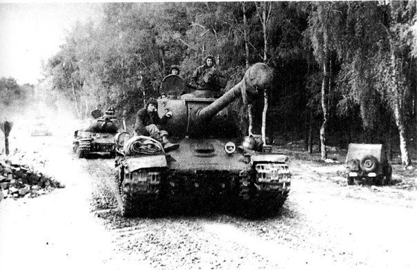 """bmashina: """" Marching column of heavy tanks is-2 of the 1st Ukrainian front on the approaches to Berlin. At the roadside stands vehicle Willys MB,1945. """""""