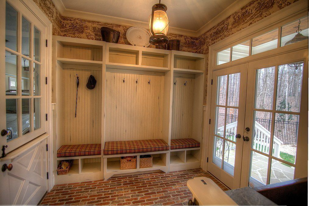 Mudroom With Beautiful French Doors And Brick Floor