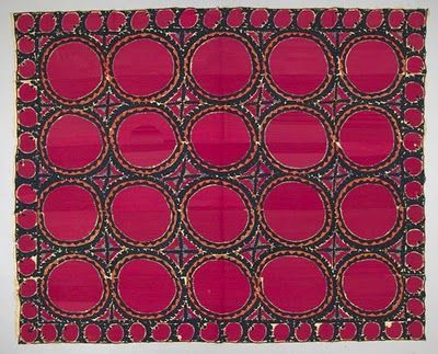 """Palak cloth. Suzani  The solid red circles are embroidered with such fine couching, that they look woven.   Silk and wool embroidery on plain cotton ground.  About 1860. From Bokhara, Uzzbekistan  The circles are cosmological symbols (moon, sun)   About 100 inches across, 90"""" down."""