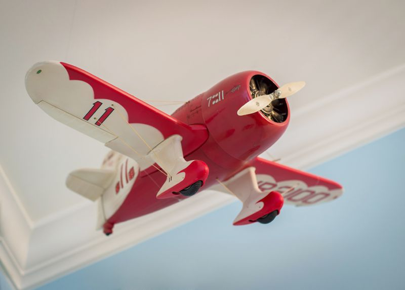 Hang a model airplane from the ceiling for an aviation themed room