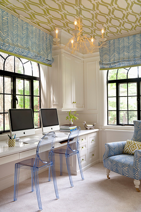 These focal windows adorned with fresh quadrille roman shades draw your eyes to the ceiling for another unexpected fun twist to this well decorated home