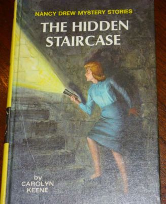 Nancy Drew. Totally remember this book cover and boy, was I spooked! Now I want to read all these books to remember what it was about!