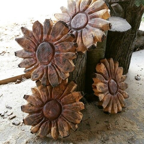 Chainsaw carved flowers follow the carver on instagram under