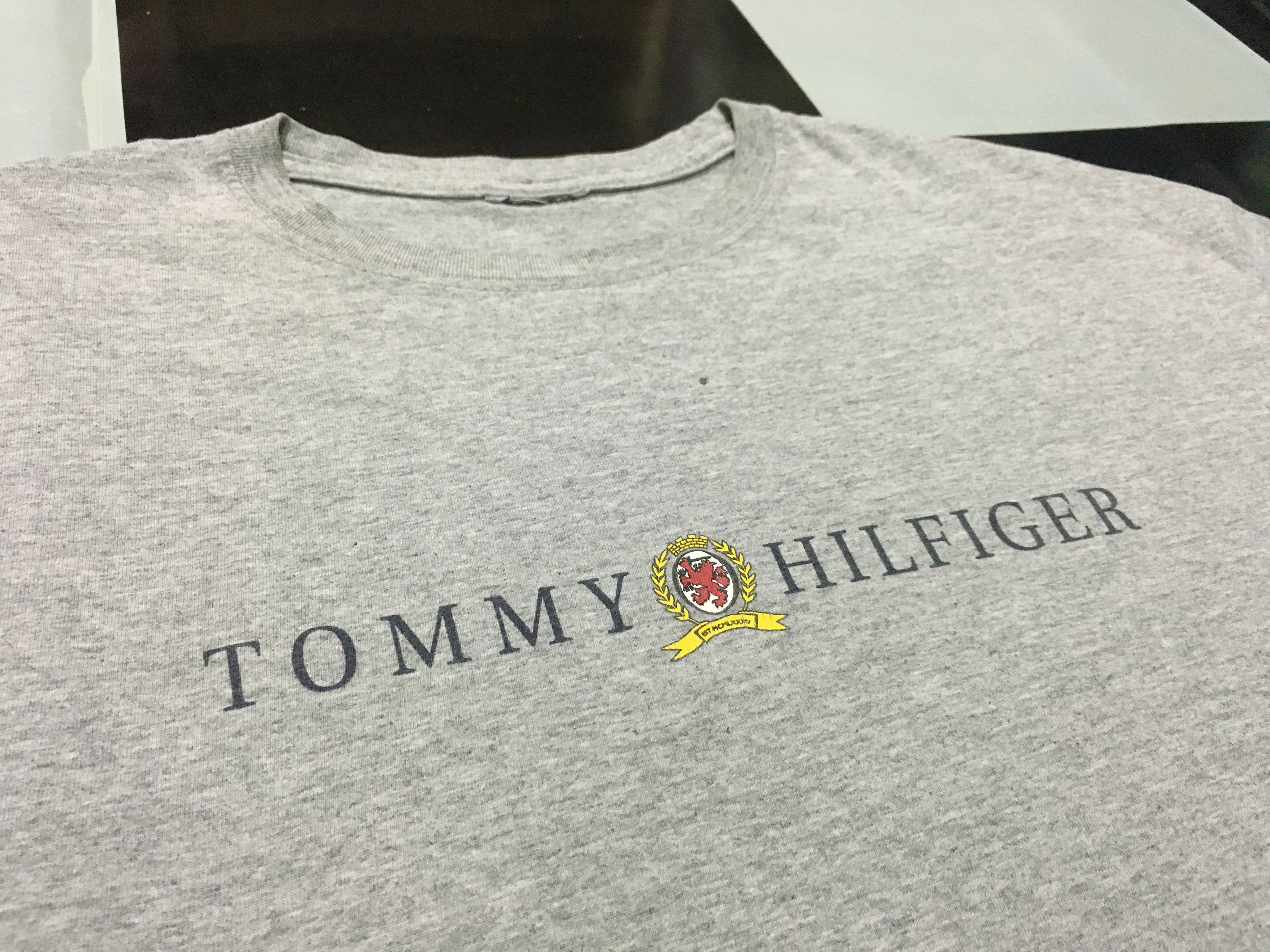 6e53ac334 Vintage Tommy hilfiger t shirt spell out logo lion crest Gray Size L Good  condition by AlivevintageShop on Etsy