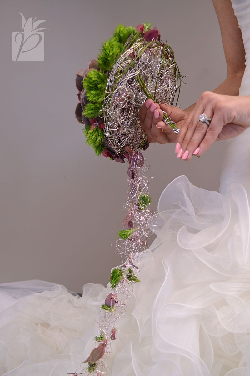 A backside view of the succulent cascading bouquet using Oasis ...