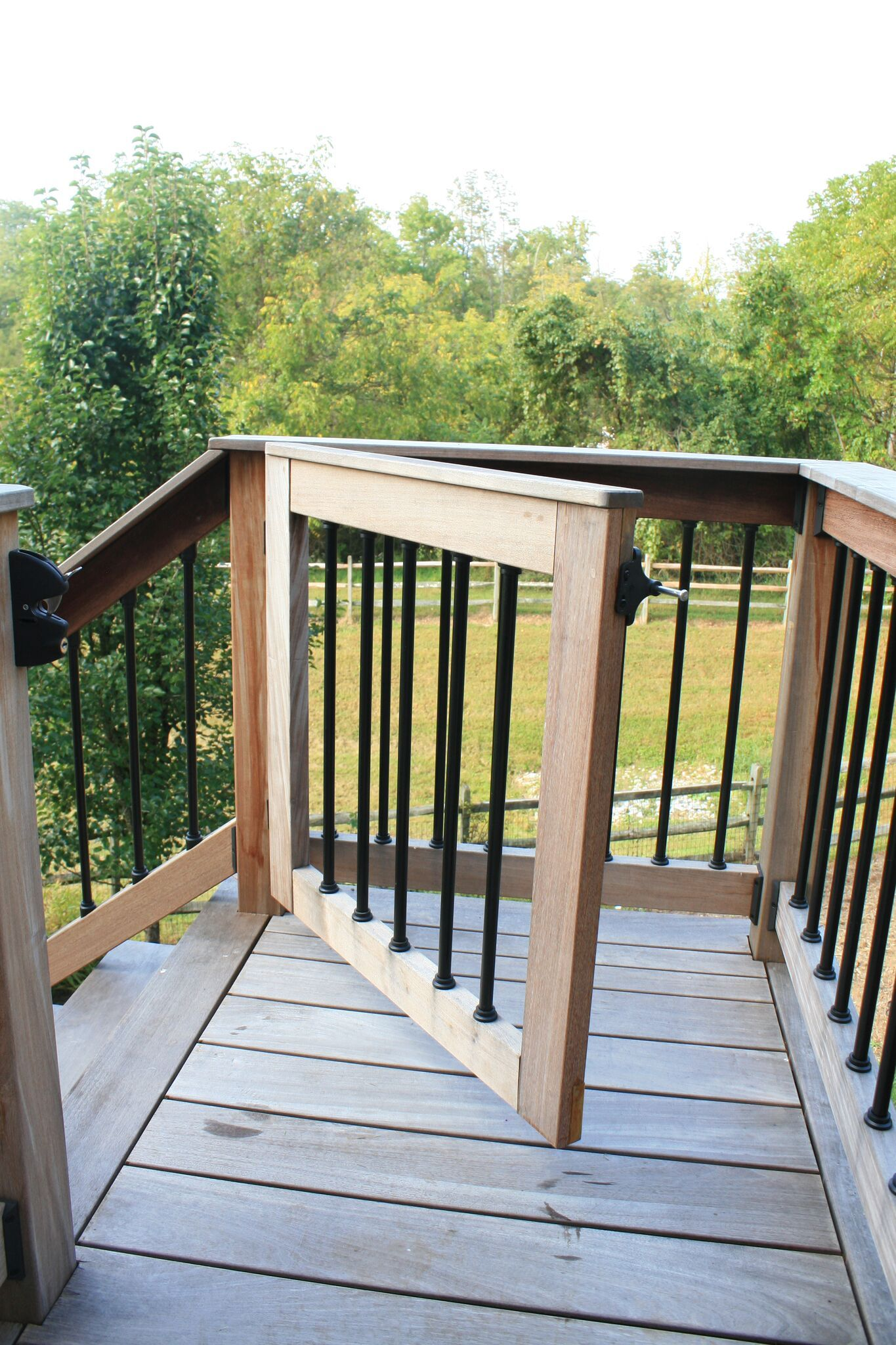 Got kids got pets if youre wondering if its possible to install a gate at the top of a potentially dangerous staircase weve got you covered our lancaster county deck builders can help to secure your new deck baanklon Choice Image