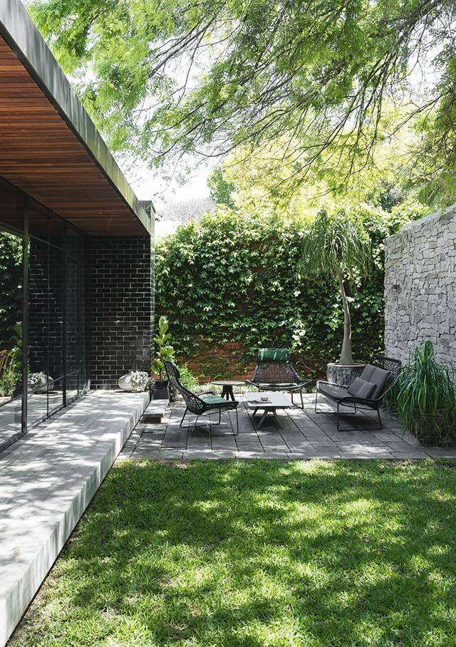 Low garden furniture works well in this small but perfectly shaped outdoor area