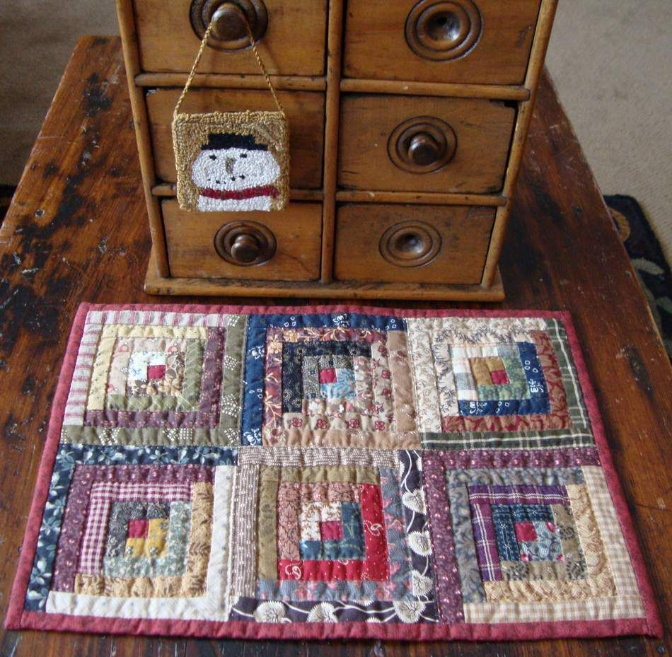 Tiny little log cabin quilt