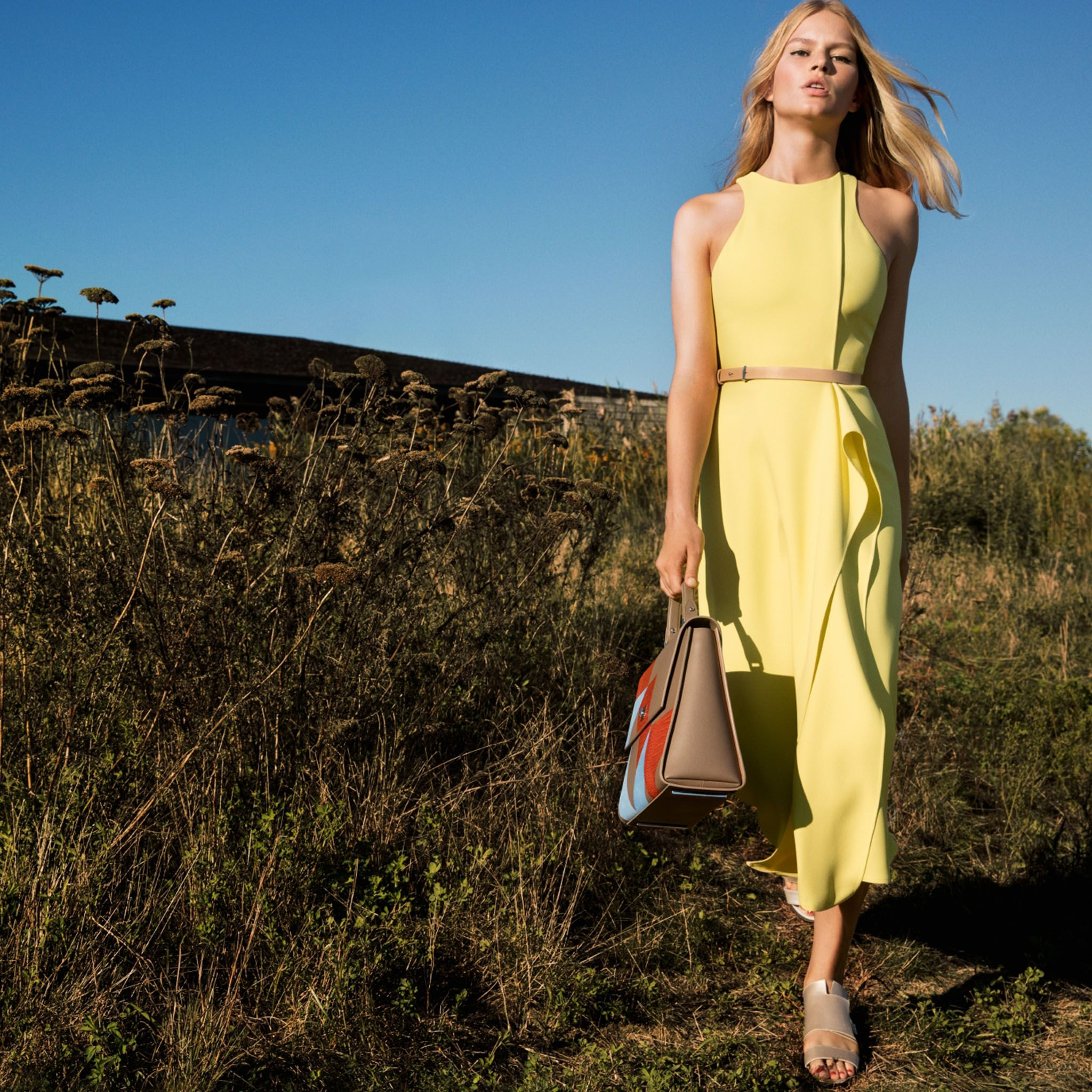 Anna Ewers wears a zest yellow dress with the new patchwork edition BOSS Bespoke bag in the Spring/Summer 2016 campaign #thisisboss