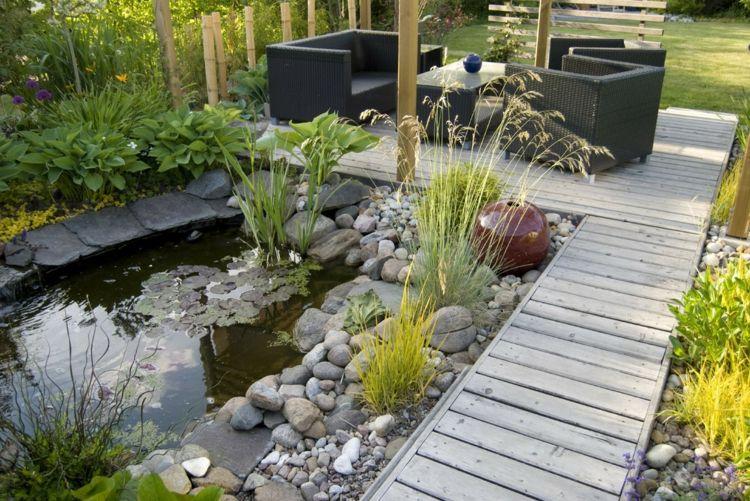 moderne gartengestaltung steinen teich anlegen graeser platten holz - Gartengestaltung Mit Steinen Und Grasern