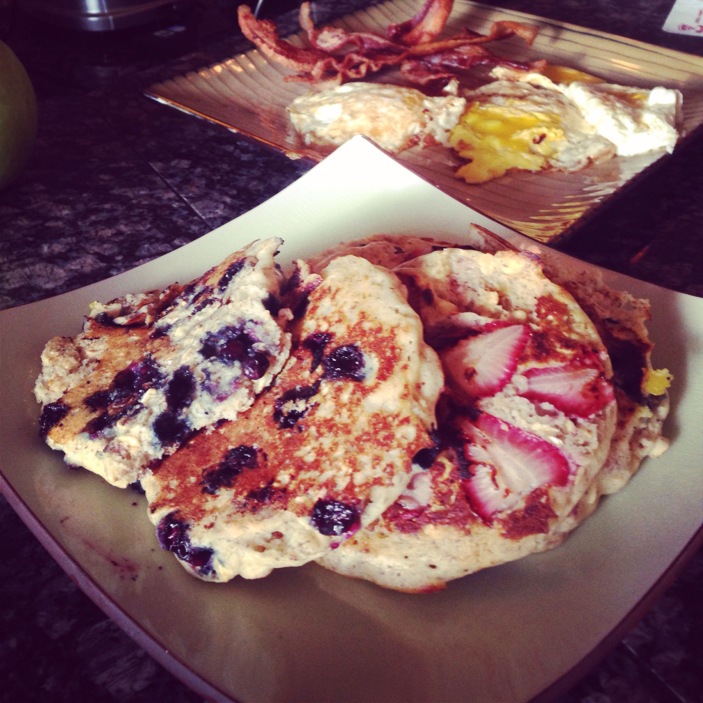Breakfast for dinner: GF strawberry and blueberry pancakes made with Pamela's mix with rolled oats and ground flax mixed in, smokehouse bacon, and three large brown eggs fried in the bacon grease. Oh my crap. So good. @Cherie Miller