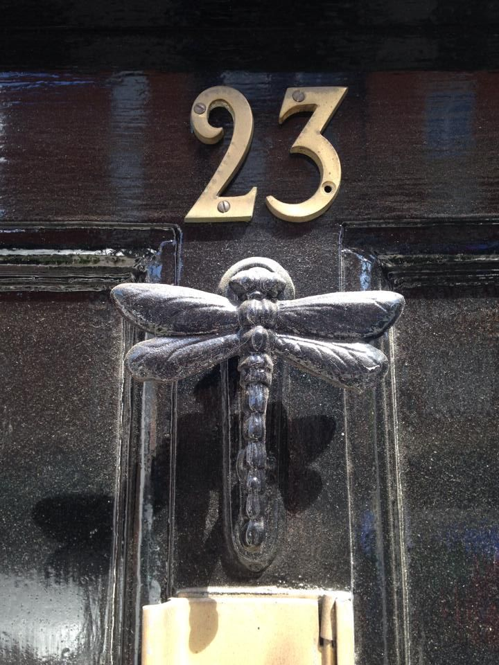 Black Door With Dragonfly Door Knocker, England