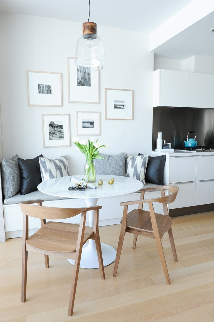 dining nook with built in bench // light gray and white living room // industrial glass pendant light