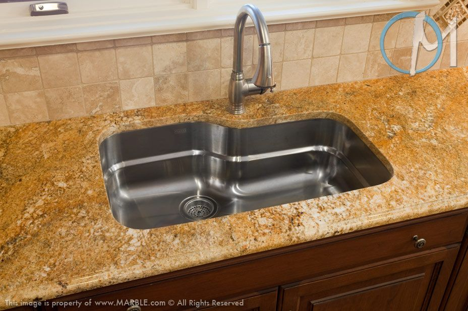 The metallic color of this stainless steel sink cools down for Colored stainless steel sinks
