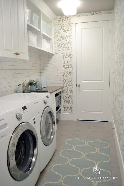Blue And Gray Laundry Room Features Walls Clad In Blue And Grey