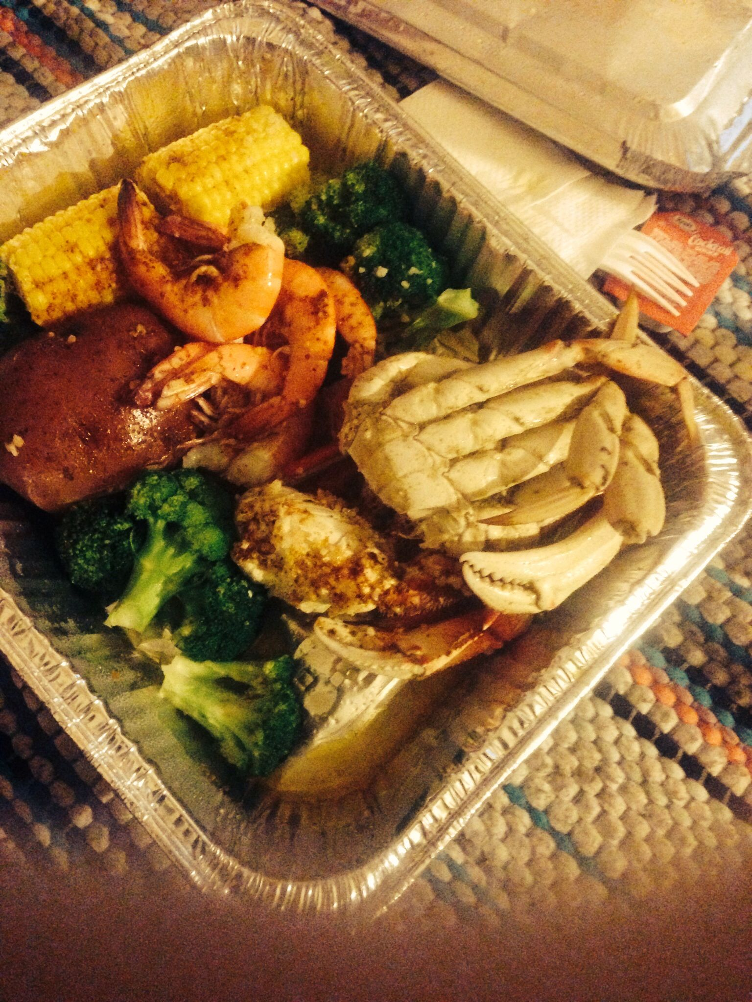 Crab legs, jumbo shrimp, corn, broccoli, potatoes