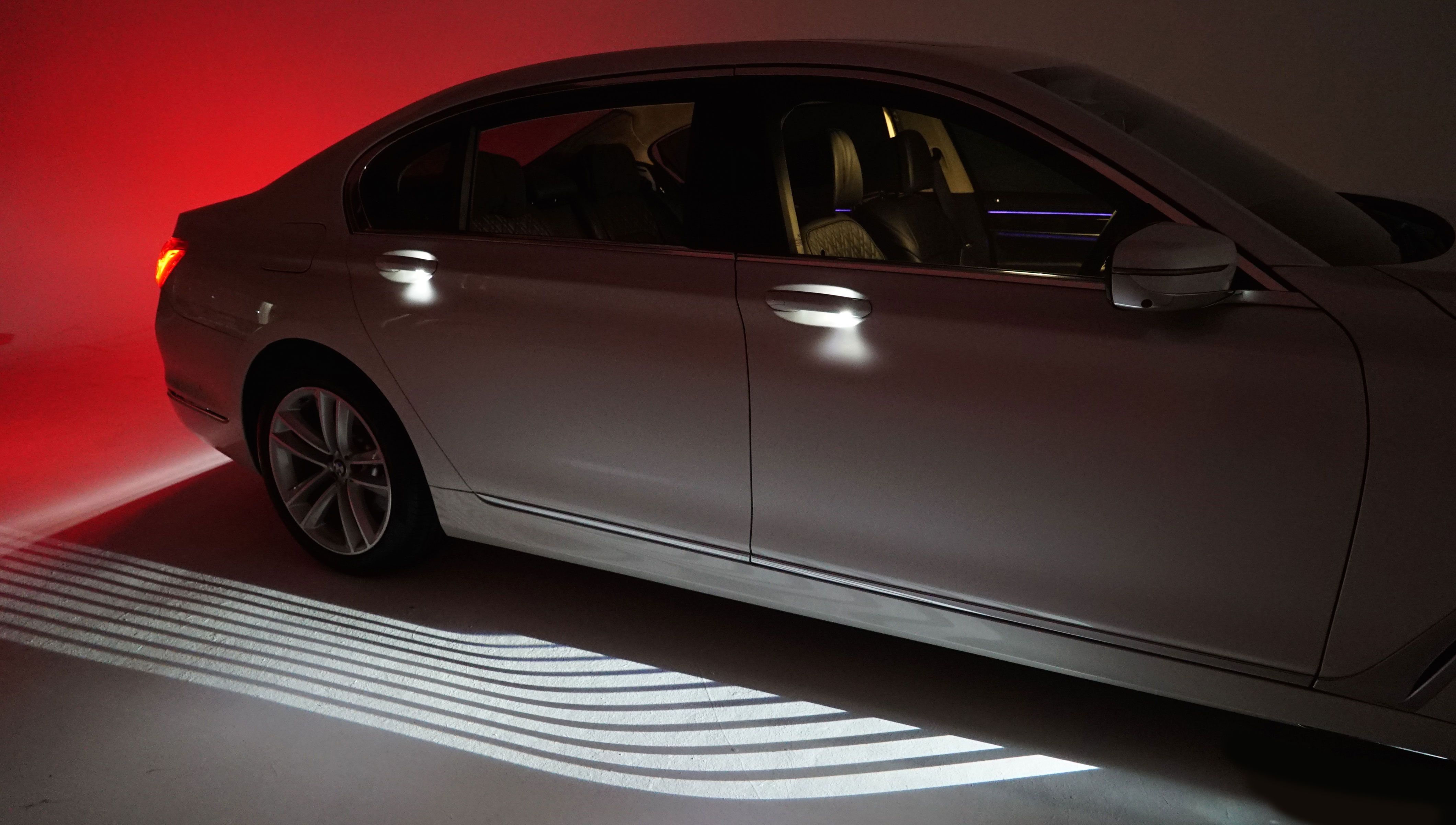 Bmw 7 Series 2016 Welcome Light Carpet It Took 3 Years To Get This Into Production Bmw 7series Exteriorlights Ca Luxury Car Interior Bmw Luxury Cars