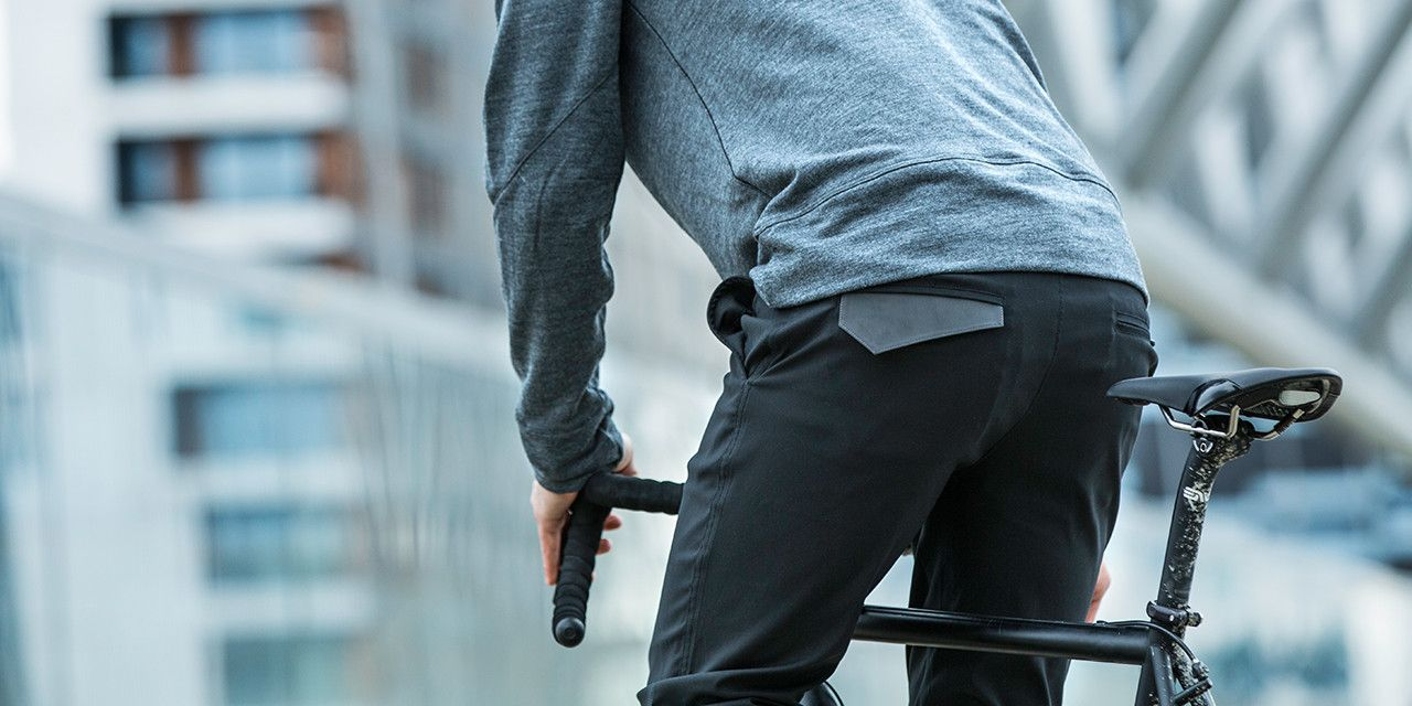 Bike Pant - stretch fabric w  a reflective back-pocket flap that can be  tucked in while at work and untucked for the ride home and 3XDRY® wicking  technology ... 97e1a374e