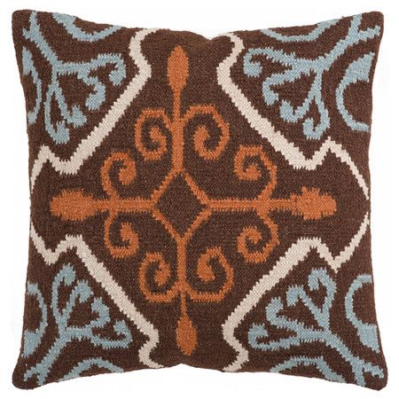 Pillow with an ikat-inspired medallion motif. Made in India.  Product: PillowConstruction Material: Wool and cot...