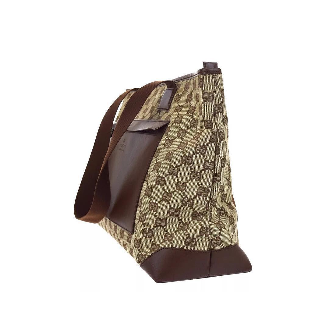 e4a6e7ebc9c8 gucci large shoulder tote leather front pocket and signature supreme canvas  measures 14 x 11 x