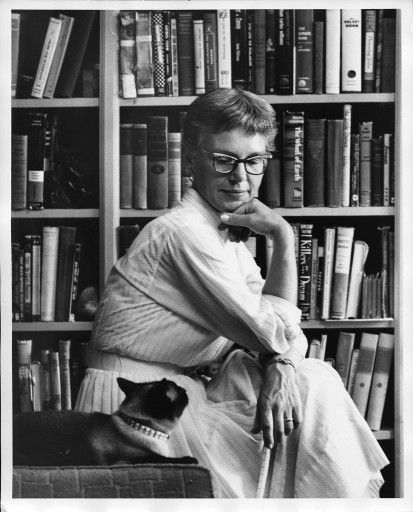 Helga Sandburg, the youngest daughter of poet Carl Sandburg with her Siamese cat.