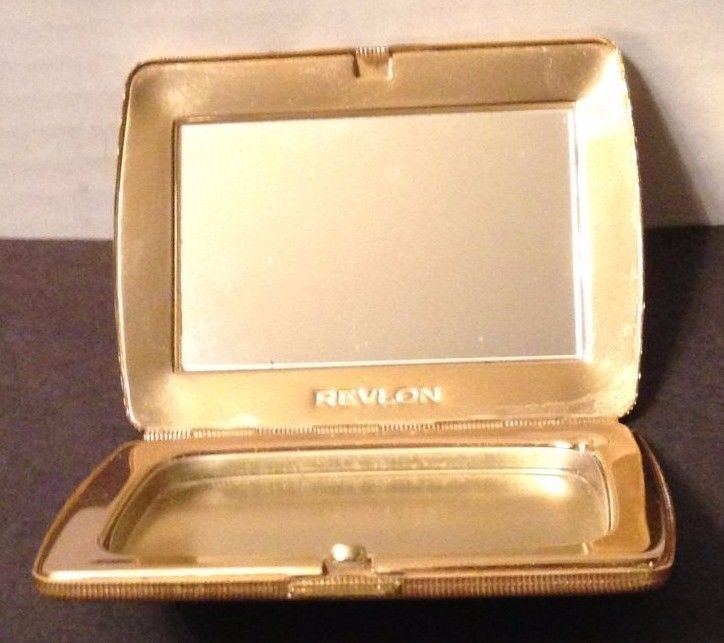 Vintage gold tone  compact with mirror from Revlon