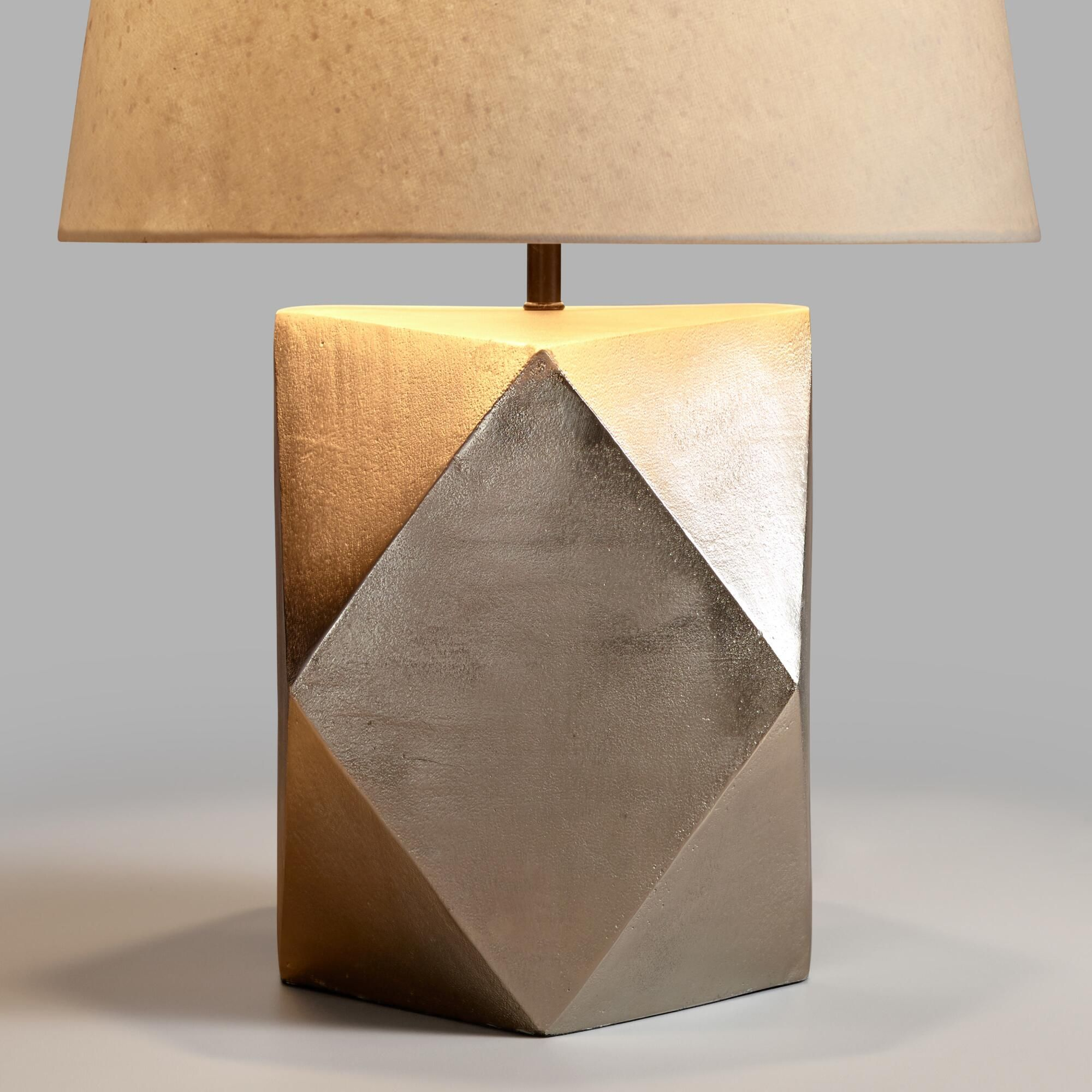 Crafted of faceted metal with a pewter finish our exclusive table crafted of faceted metal with a pewter finish our exclusive table lamp adds a geometric geotapseo Image collections
