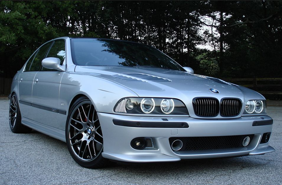 BMW E39 M5 silver with tinted windows, vented hood and