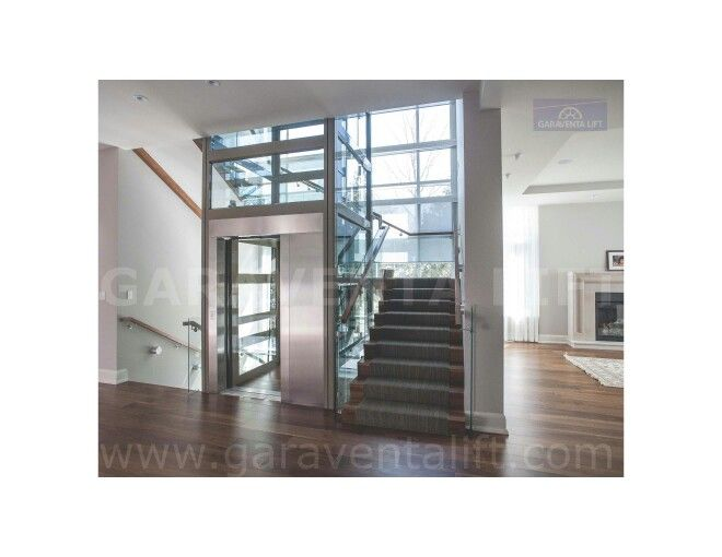 Garaventa home elevator in a glass hoistway www for Www garaventalift com