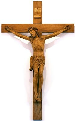 A cross with a representation of Jesus' body hanging from it. It is primarily used in Catholic, Anglican, Lutheran, and Eastern Orthodox churches (where the figure is painted), and it emphasizes Christ's sacrifice— his death by crucifixion.