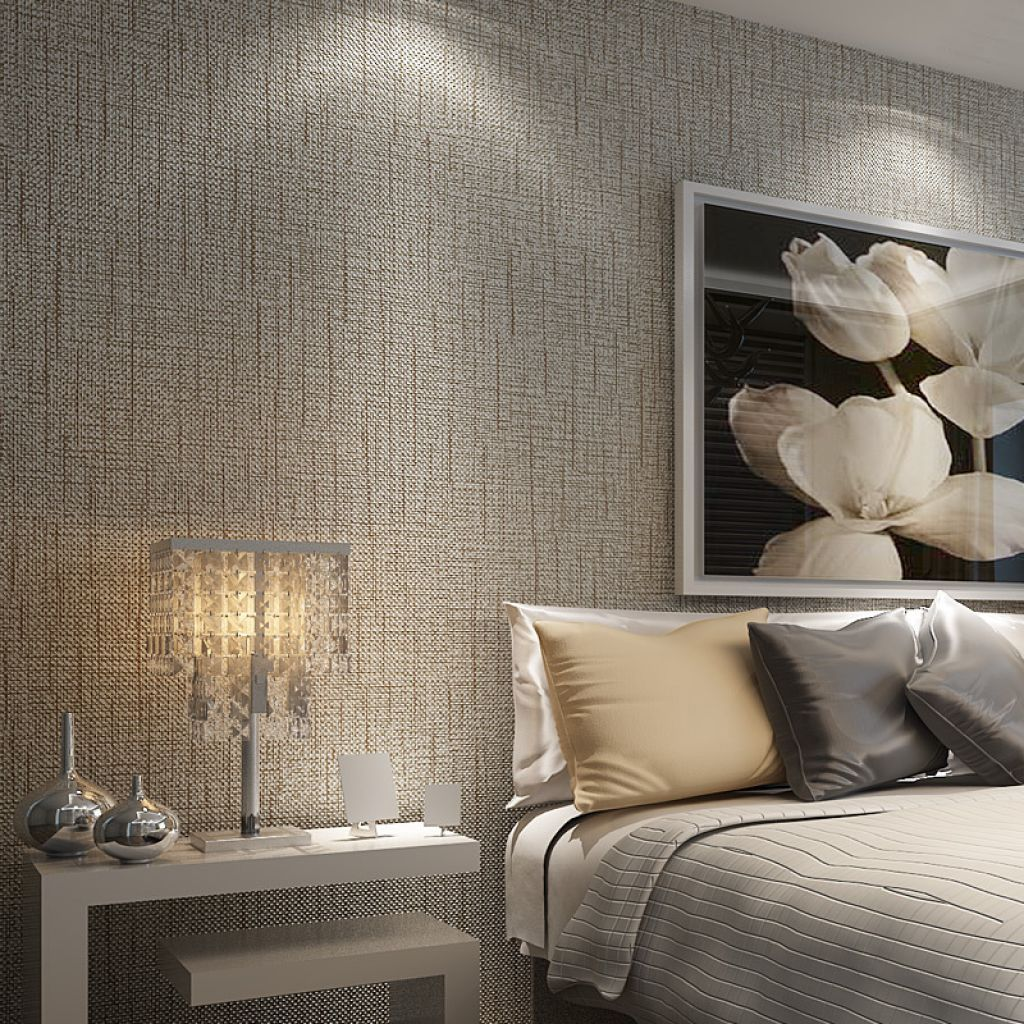 Bedroom With Modern Furniture And Textured Wallpaper