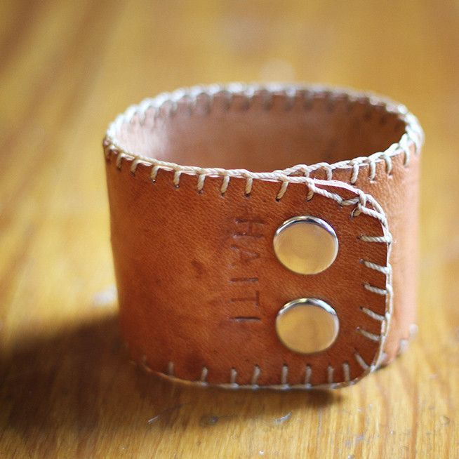 Classy Boho, genuine leather cuff--for him or her. Made in Haiti The Vineworks pledge - Each Artisan is paid a fair wage upfront, 50% of the profit is reinvested back into the country where the produc