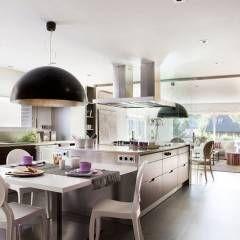 Ático en Sant Cugat. 2011: Cocinas de estilo ecléctico de Deu i Deu