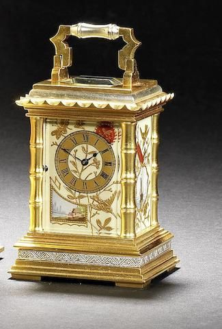 A late 19th century French silvered and gilt miniature pagoda pattern carriage timepiece