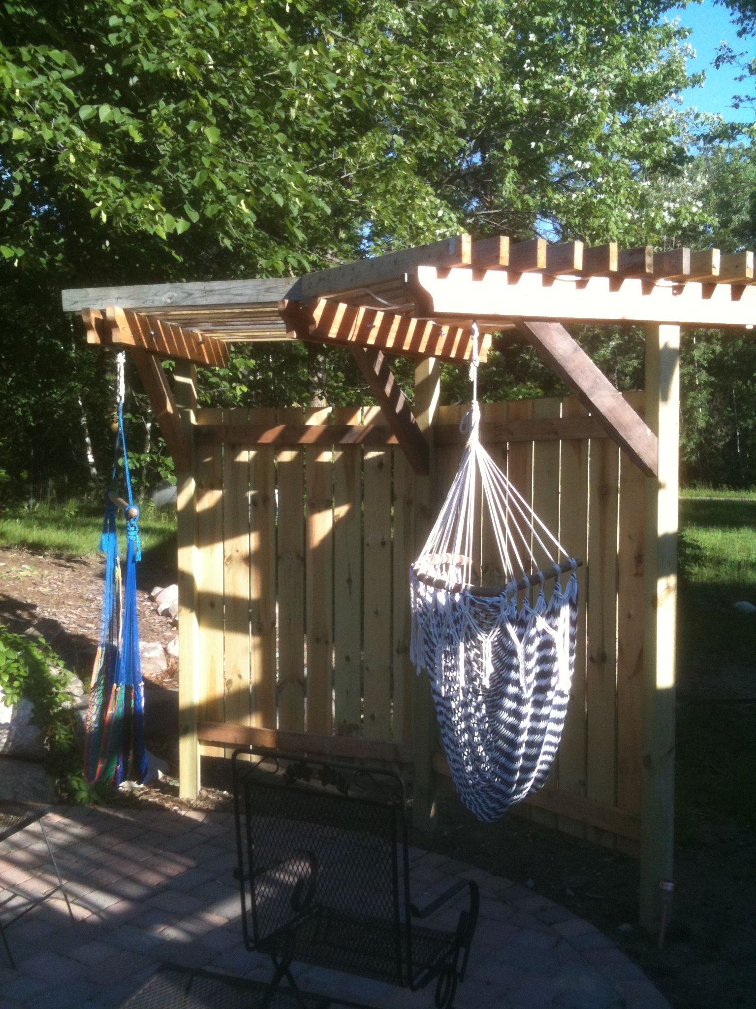 trellis or shade structure for hanging chair hammock landscapes