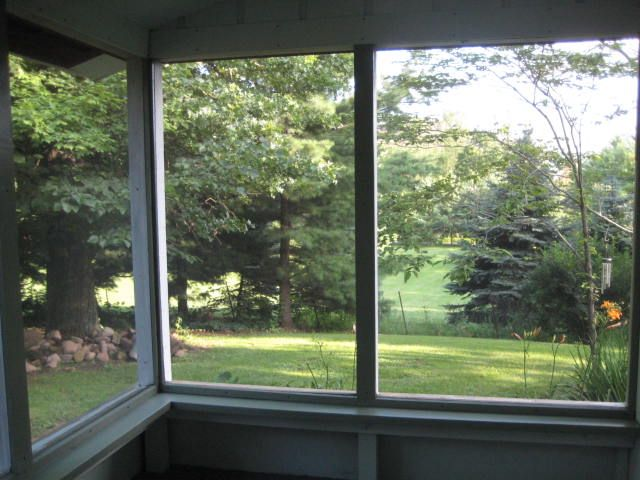Repainted screened-in porch