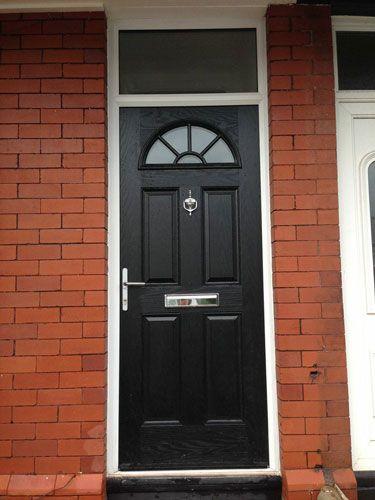 4 Panel Sunburst Composite Front Door In Black With A Top Light