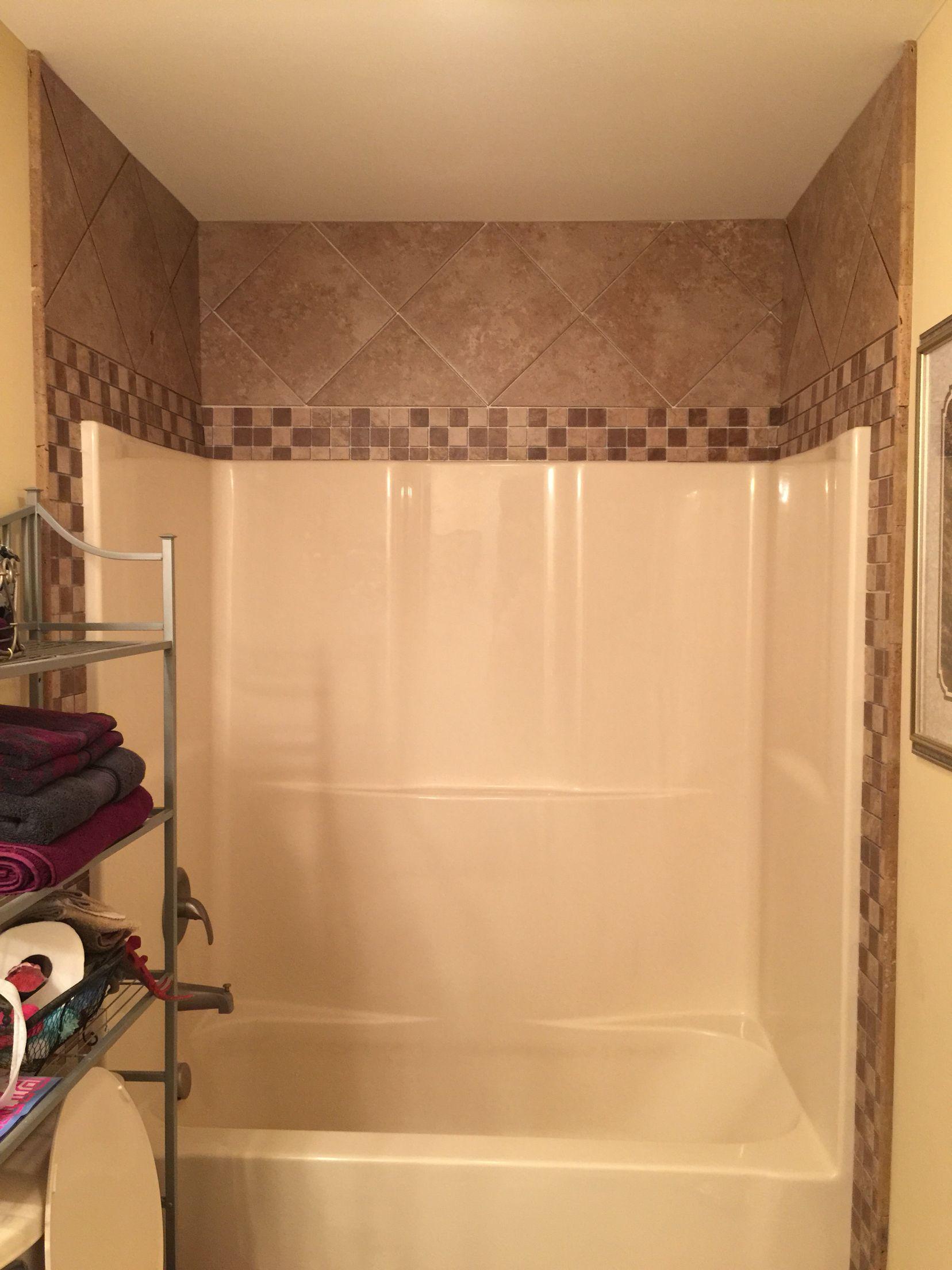 tile around fiberglass shower tub