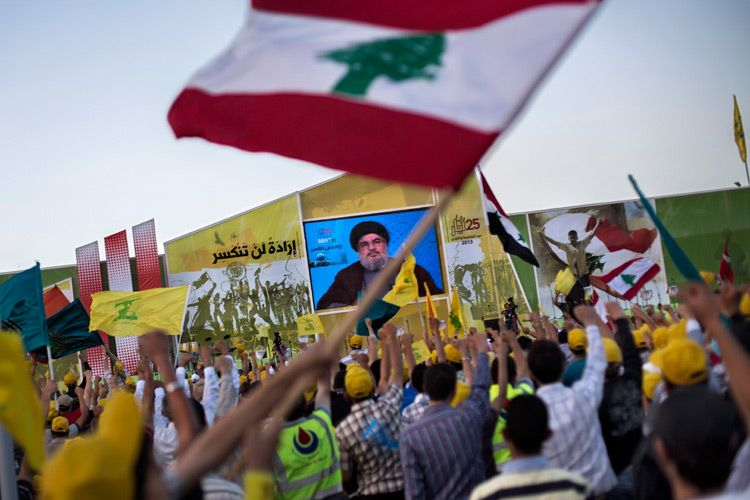 Hezbollah leader Hassan Nasrallah delivers a speech through a video link to party supporters on Liberation Day. He confirmed for the first time that Hezbollah were actively fighting in Syria.