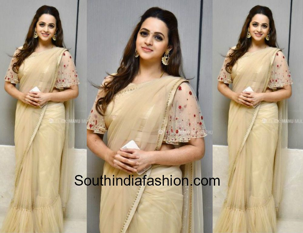 1f581d289696e5 ... attended a wedding reception recently wearing a nude net saree that has  ruffled hemline paired with matching floral embroidered ruffle sleeves  blouse.