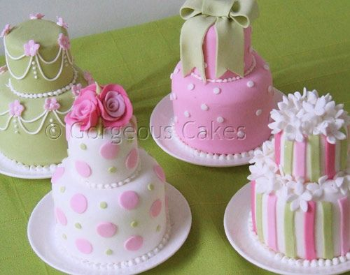 Mini Two Tiered Cakes Pretty little coordinating cakes in pink and green with sugar blossoms, polka dots and pinstripes, presented on a china plate. Each cake serves 2. There is a minimum order of 10 on mini tiered cakes.