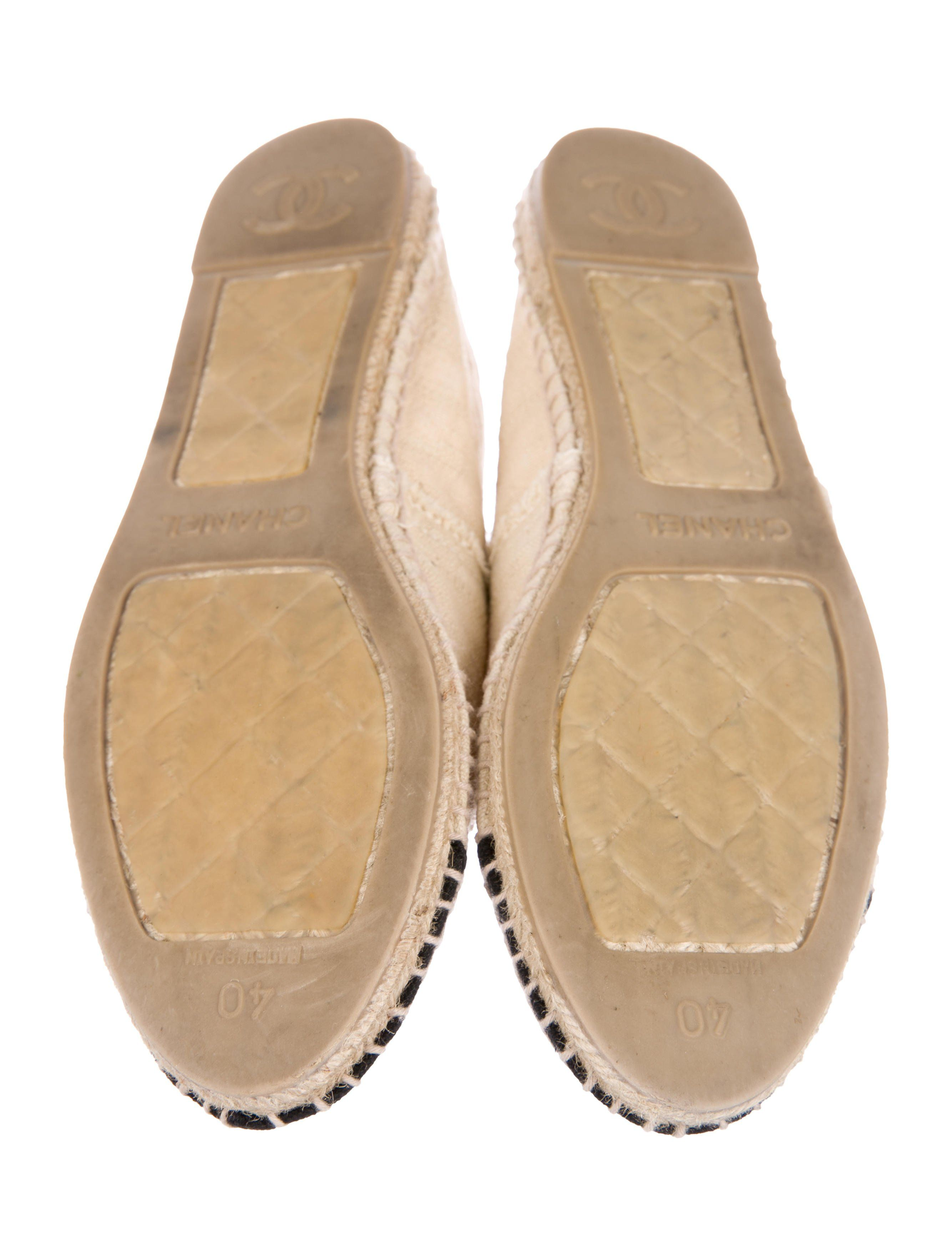 a0906ddff75 Beige and black canvas Chanel espadrille flats with round toes, CC ...