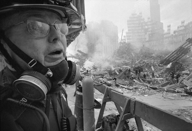 Debris was still smoldering when former NYPD detective and photographer John Botte began documenting the aftermath of 9/11 at ground zero.