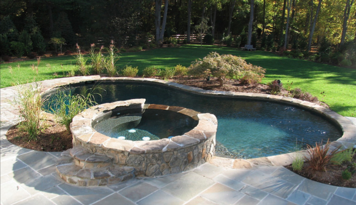 600 Sq Ft Pool Spa Combo With Custom Stepping Stone Coping And A Bluestone Patio This Pool Has A Midnight Blu Small Inground Pool Small Hot Tub Pool Remodel