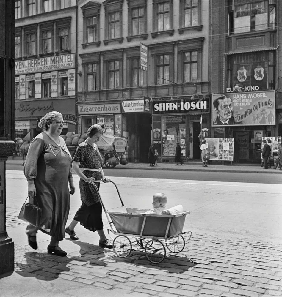 Women walking with a baby carriage, Berlin, Germany, 1939 ...