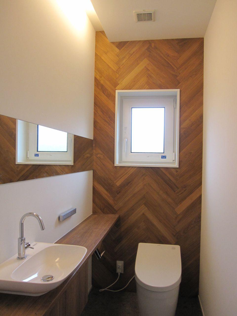 ヘリンボーンの壁材 トイレ インテリア トイレ おしゃれ トイレ 壁紙 おしゃれ