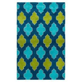 Hand-tufted New Zealand wool rug with a lattice-inspired design in blue.   Product: RugConstruction Material: 100% Blended New Zealand woolColor: Blue and greenFeatures:  HandmadeTufted  Note: Please be aware that actual colors may vary from those shown on your screen. Accent rugs may also not show the entire pattern that the corresponding area rugs have.